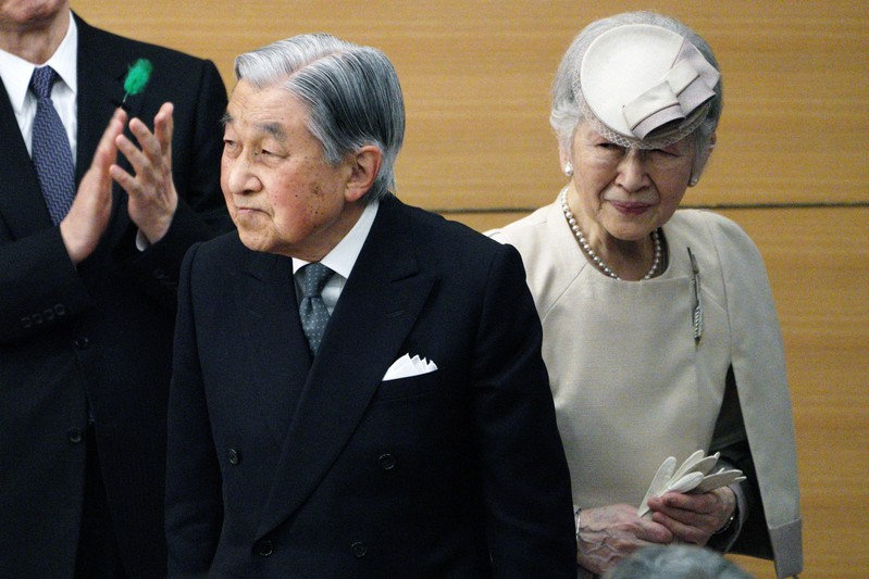 Japan's Emperor Akihito and Empress Michiko greet the guests as they leave from the stage after the awarding ceremony of the Midori Academic Prize in Tokyo.