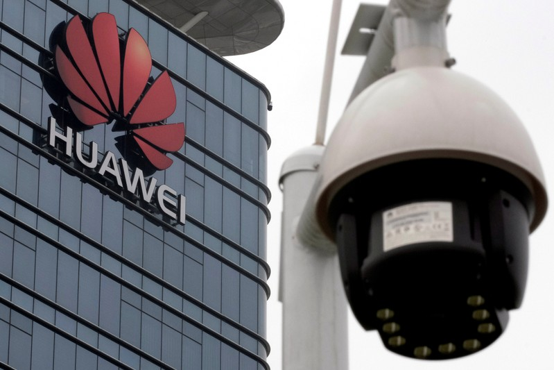 FILE PHOTO: A surveillance camera is seen in front of Huawei logo outside its factory campus in Dongguan, Guangdong province
