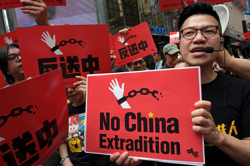 Demonstrators march during a protest to demand authorities scrap a proposed extradition bill with China, in Hong Kong