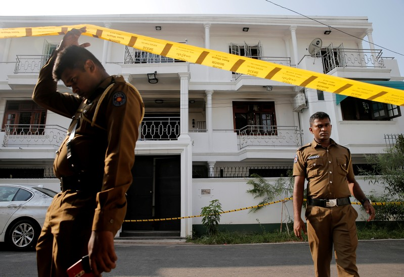 FILE PHOTO: Police keep watch outside the family home of a bomber suspect where an explosion occurred during a Special Task Force raid in Colombo