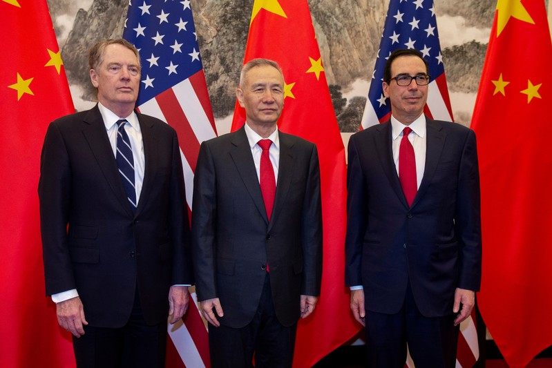 FILE PHOTO: China's Vice Premier Liu He (C) pose for a photo with U.S. Treasury Secretary Steven Mnuchin (R) and U.S. Trade Representative Robert Lighthizer (L) at Diaoyutai State Guesthouse in Beijing