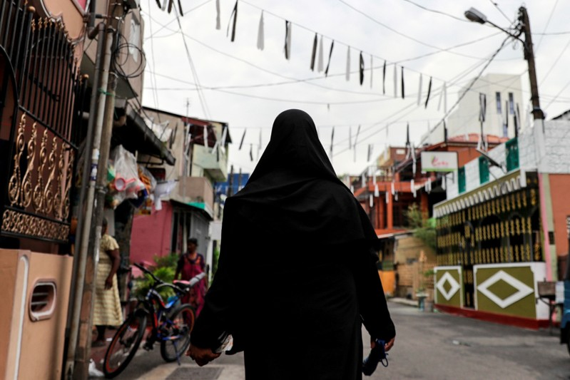 A Muslim woman wearing a hijab walks through a street near St Anthony's Shrine in Colombo