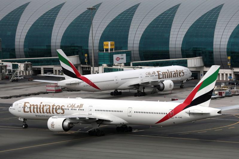 FILE PHOTO: Emirates Airline Boeing 777 planes at are seen Dubai International Airport in Dubai