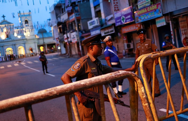 Security personnel stand guard in front of St Anthony's Shrine in Colombo