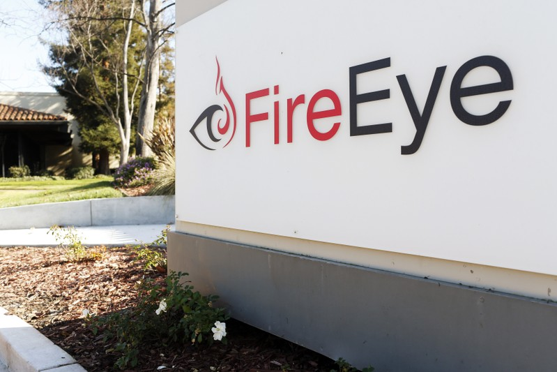 FireEye logo is seen outside the company's offices in Milpitas, California