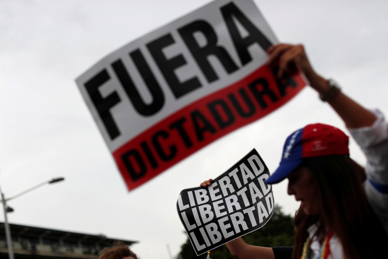 Supporters of Venezuelan opposition leader Juan Guaido, who many nations have recognized as the country's rightful interim ruler, take part in a protest in Panama City