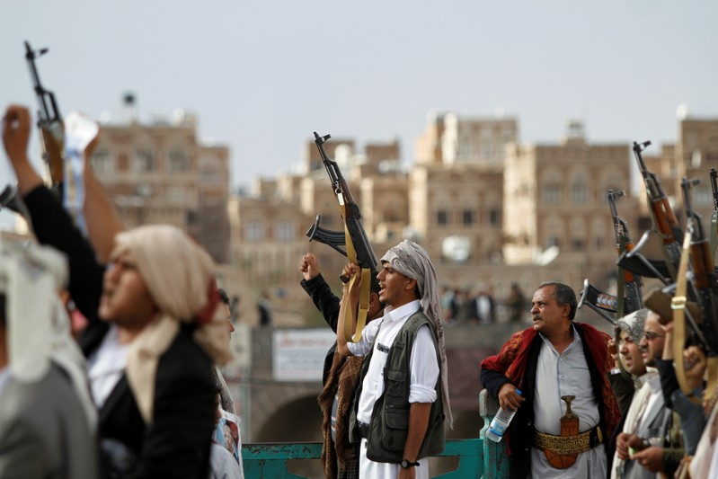 FILE PHOTO - Houthi supporters attend a rally to mark the first anniversary of the killing of Saleh al-Sammad, who was the head of Houthi movement's Supreme Political Council, by an air strike, in Sanaa