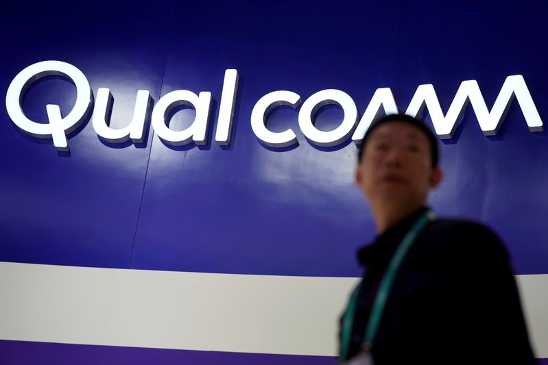 FILE PHOTO: A Qualcomm sign is seen during the China International Import Expo (CIIE), at the National Exhibition and Convention Center in Shanghai