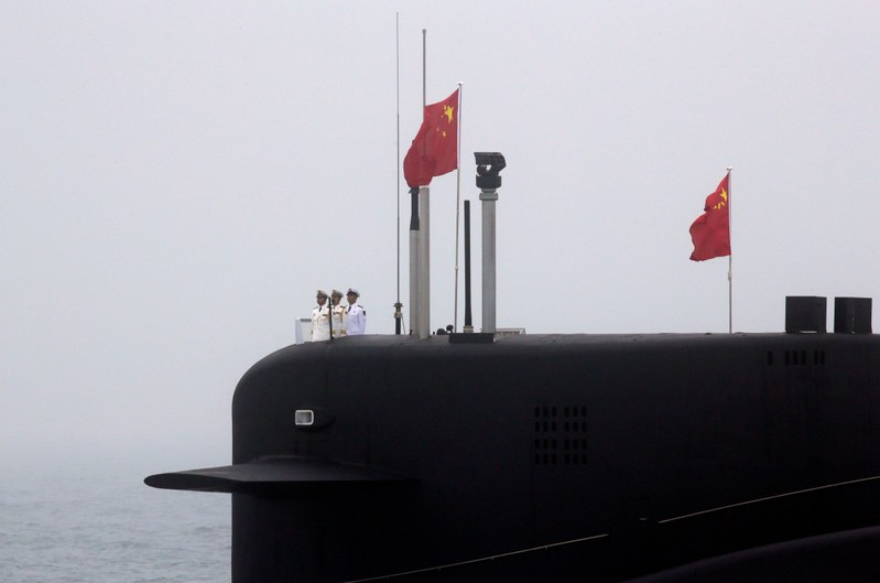 FILE PHOTO: Chinese Navy's nuclear-powered submarine Long March 10 takes part in a naval parade off the eastern port city of Qingdao, to mark the 70th anniversary of the founding of Chinese People's Liberation Army Navy