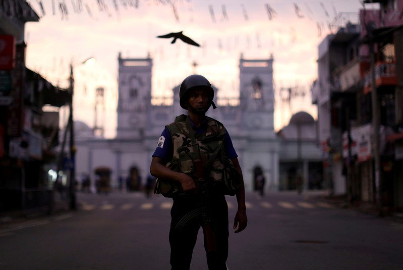 FILE PHOTO: A security officer stands guard outside St. Anthony's Shrine in Colombo