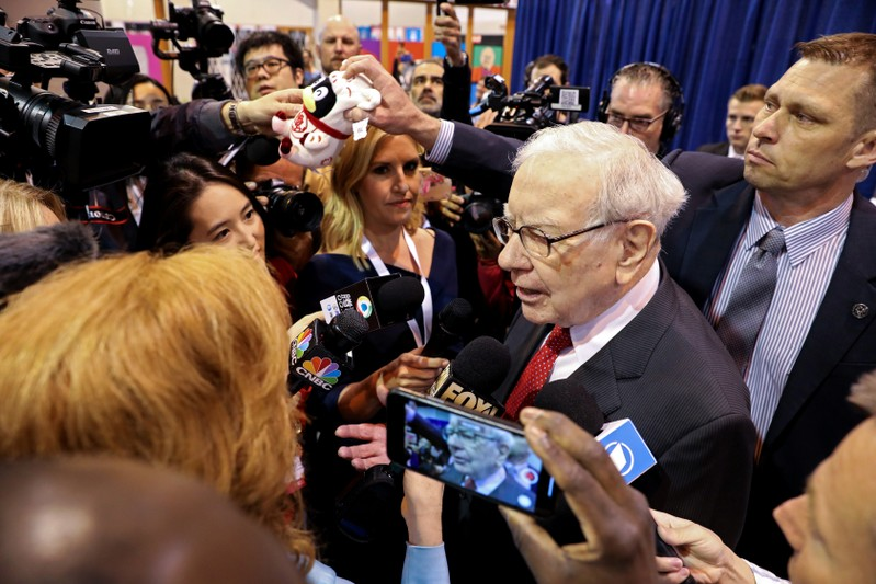 Berkshire Hathaway Chairman Warren Buffett walks through the exhibit hall as shareholders gather to hear from the billionaire investor at Berkshire Hathaway Inc's annual shareholder meeting in Omaha
