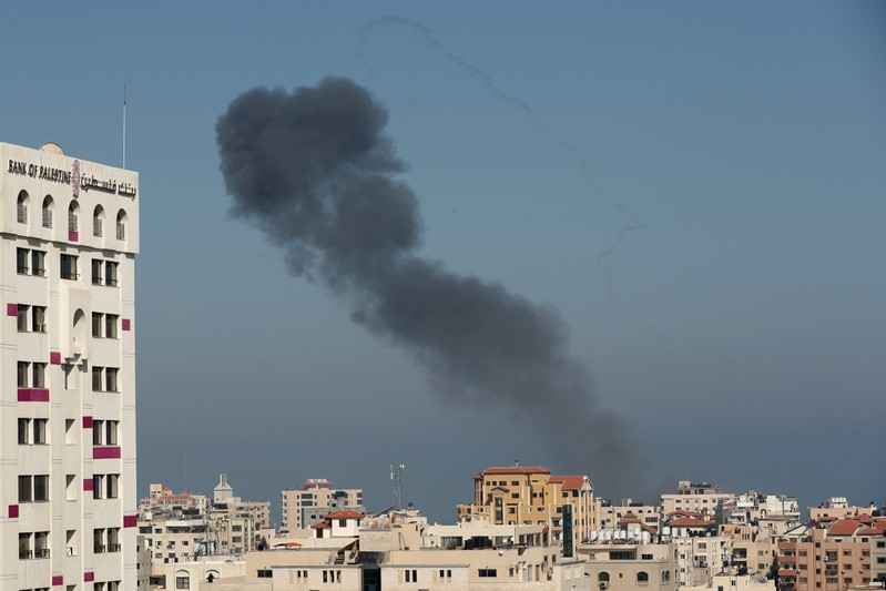 Smoke rises following an Israeli air strike in Gaza City