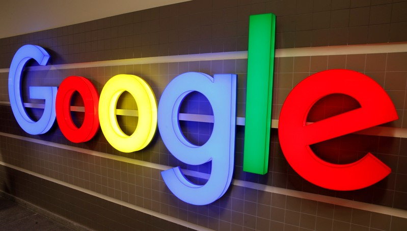 FILE PHOTO: An illuminated Google logo is seen inside an office building in Zurich