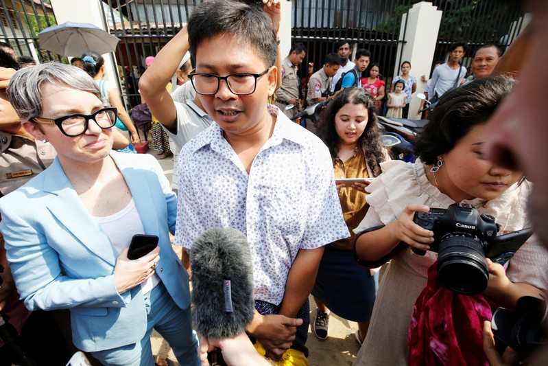 Reuters reporter Wa Lone speaks to media after he is freed from Insein prison after receiving a presidential pardon in Yangon
