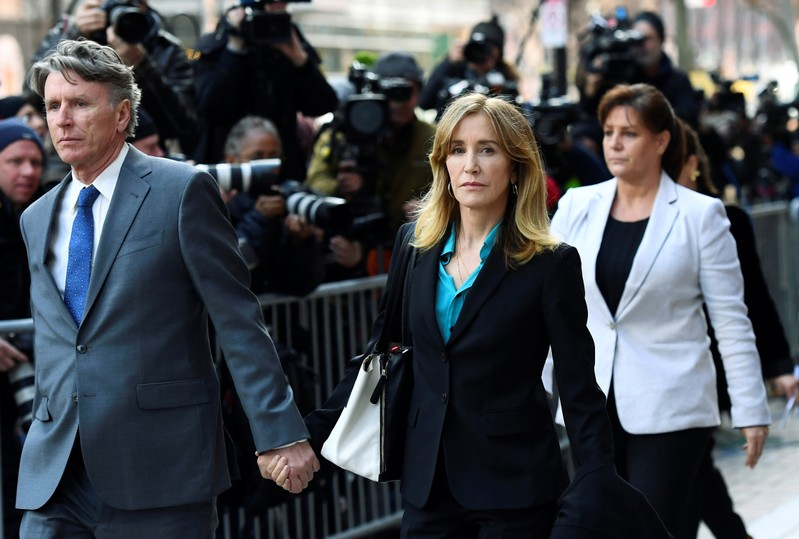 FILE PHOTO  - Actor Felicity Huffman leaves the federal courthouse after facing charges in a nationwide college admissions cheating scheme in Boston