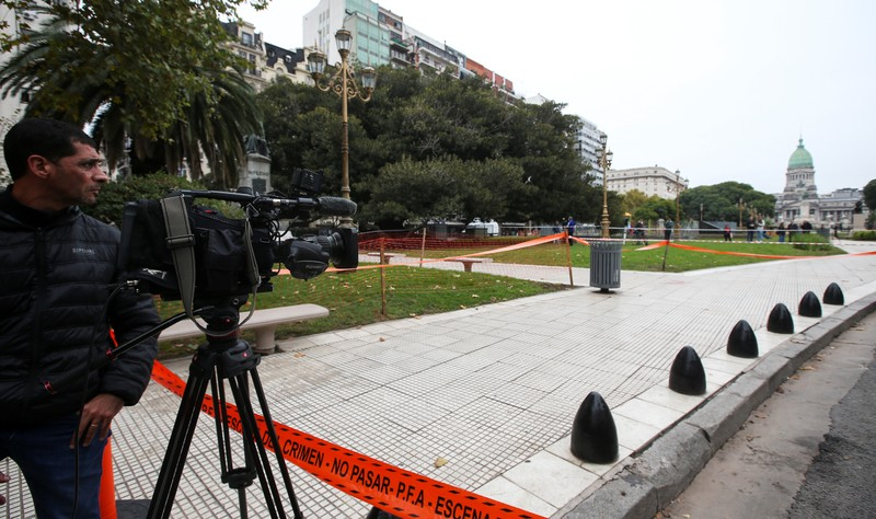 A cameraman works at the crime scene where Argentine Congressman Hector Olivares was injured and his adviser, Miguel Yadon, was killed in an attack near the National Congress in Buenos Aires