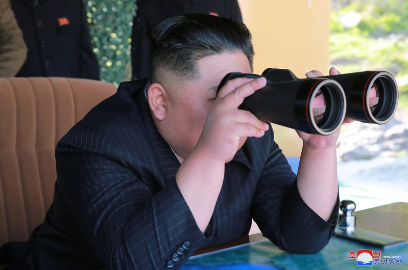 North Korea's leader Kim Jong Un supervises a military drill in North Korea