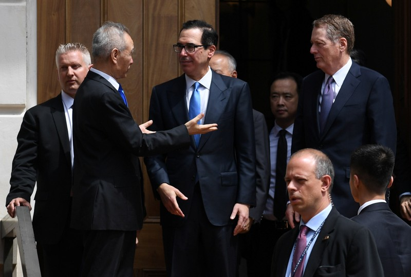 Chinese Vice Premier Liu He talks with U.S. Treasury Secretary Mnuchin and Trade Representative Lighthizer as he leaves trade talks in Washington