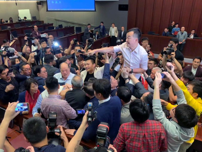 Pro-democracy lawmakers clash with pro-Beijing lawmakers during a meeting for control of a meeting room to consider the controversial extradition bill, in Hong Kong