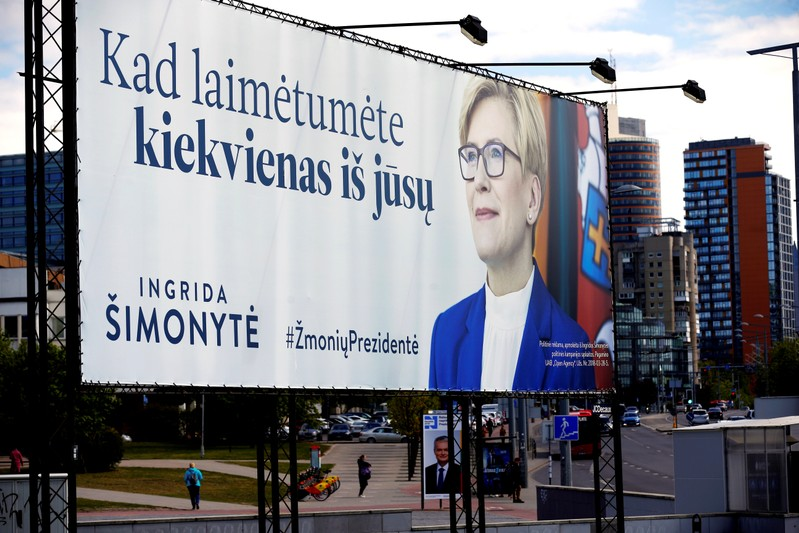Lithuanian presidential candidate Ingrida Simonyte's campaign placard is seen in Vilnius