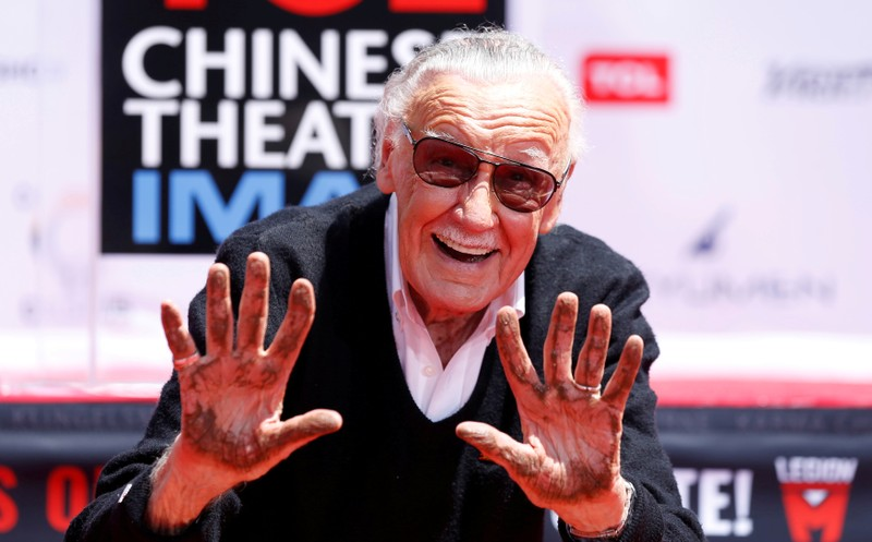 FILE PHOTO: Marvel Comics co-creator Lee shows his hands after placing them in cement during a ceremony in the forecourt of the TCL Chinese theatre in Los Angeles