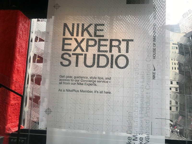 A sign is seen at the Nike flagship store on Fifth Ave in Manhattan, with a top floor dedicated to Nike Plus members where they can shop for exclusive merchandise, in New York