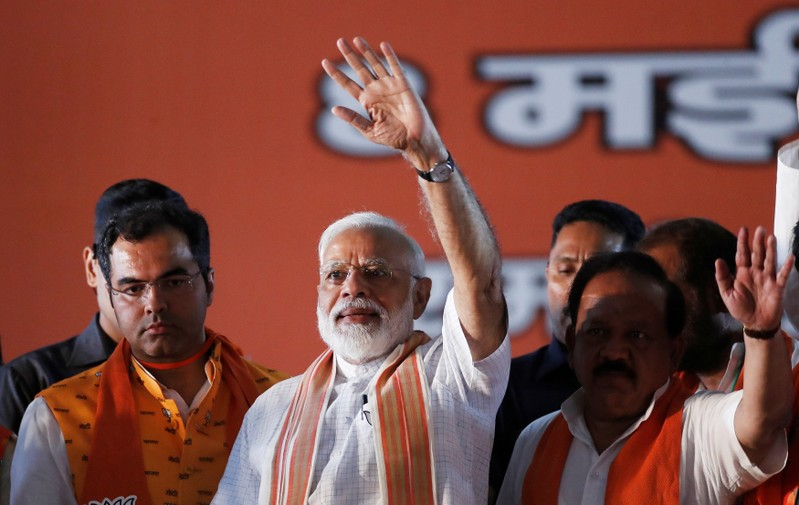 India's Prime Minister Narendra Modi waves towards his supporters during an election campaign rally in New Delhi
