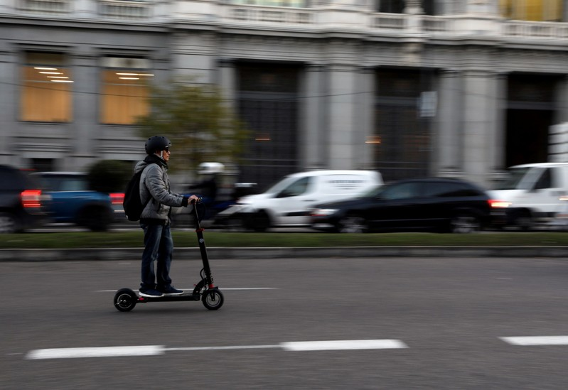 FILE PHOTO: A man rides an electric scooter in Madrid