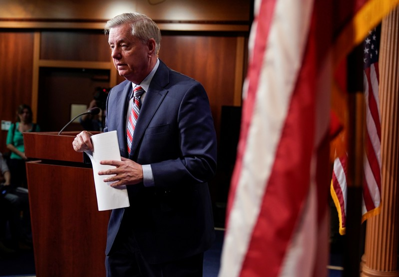 FILE PHOTO: Chairman of the Senate Judiciary Committee Lindsey Graham (R-SC) speaks to the media on Capitol Hill in Washington.