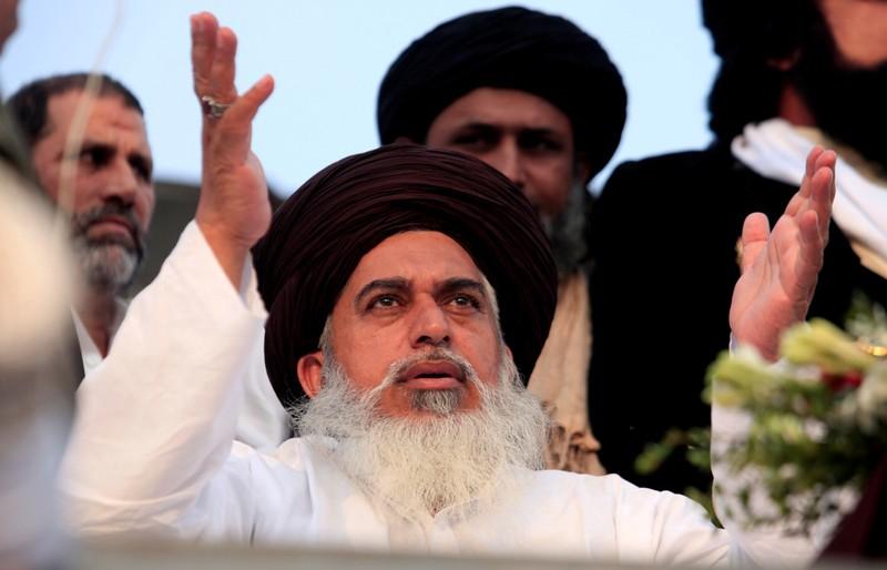 FILE PHOTO: Khadim Hussain Rizvi, leader of the Tehreek-e-Labaik Pakistan an Islamist political party, leads members in shouting slogans during a sit-in in Rawalpindi
