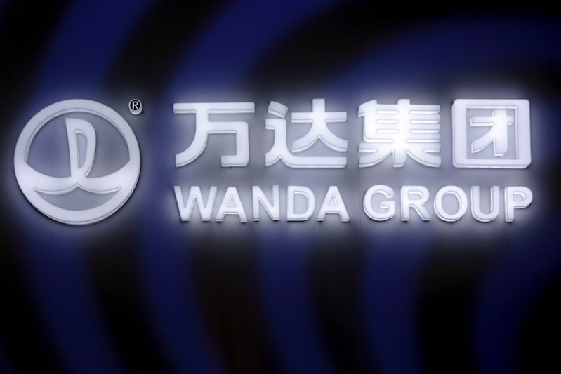 FILE PHOTO: A sign of Dalian Wanda Group in China glows during an event announcing strategic partnership between Wanda Group and FIFA in Beijing