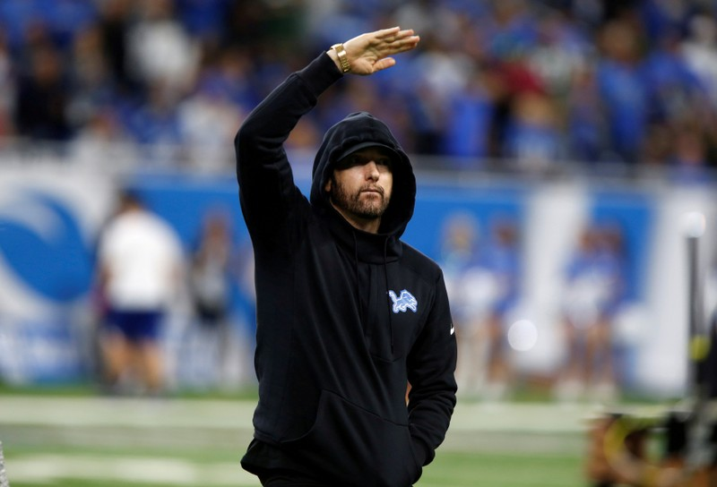 FILE PHOTO: American rapper Marshall Mathers, professionally known as Eminem, reacts as he walks off the field after a pre-game coin toss between the Detroit Lions and the New York Jets before their NFL game in Detroit, Michigan