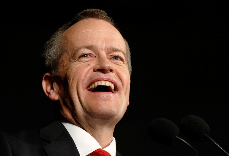 Australian Labor Party opposition leader Bill Shorten laughs during remarks at his election night party in Melbourne
