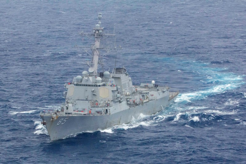 U.S. Navy handout photo of the Arleigh Burke-class guided-missile destroyer USS McCampbell during a division tactics exercise in the South China Sea
