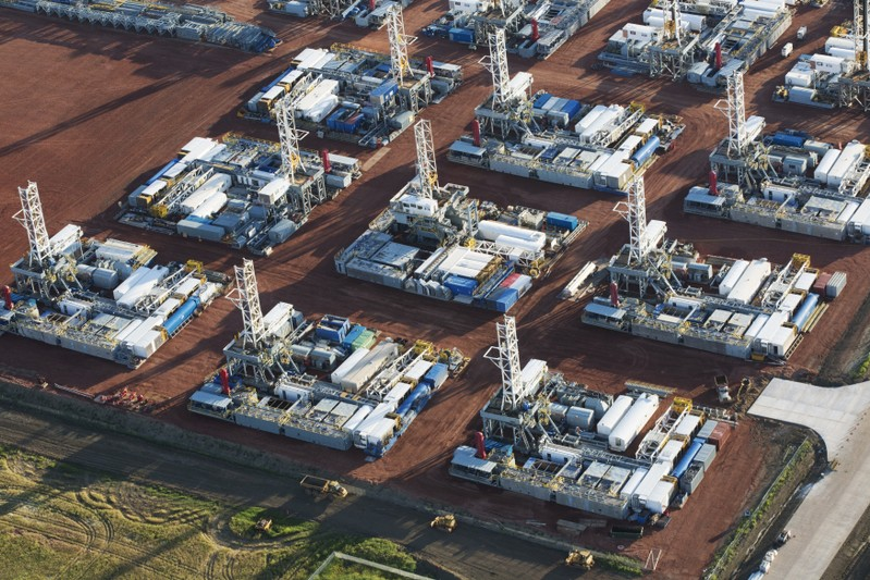 FILE PHOTO: Stacked rigs are seen along with other idled oil drilling equipment at a depot in Dickinson
