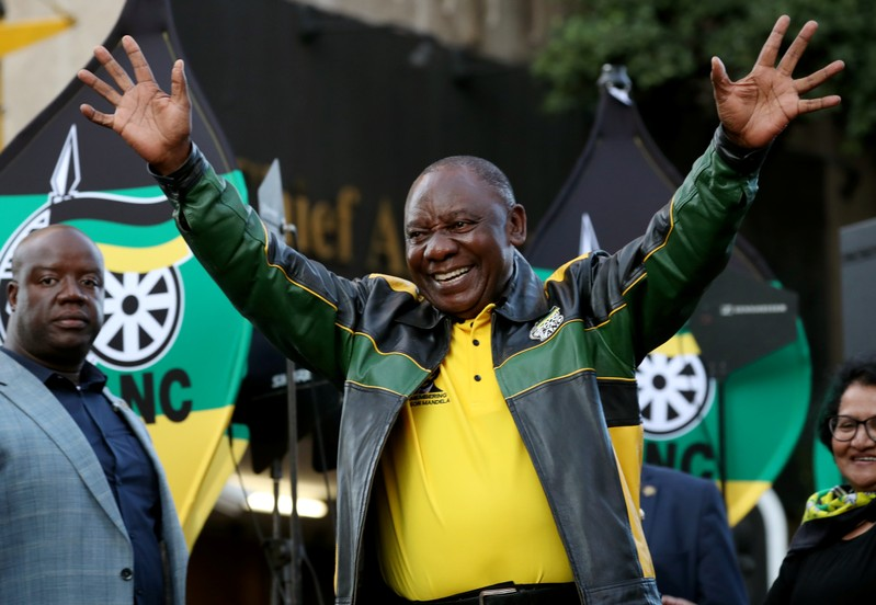 FILE PHOTO: President Cyril Ramaphosa waves to supporters of his ruling African National Congress (ANC) at an election victory rally in Johannesburg