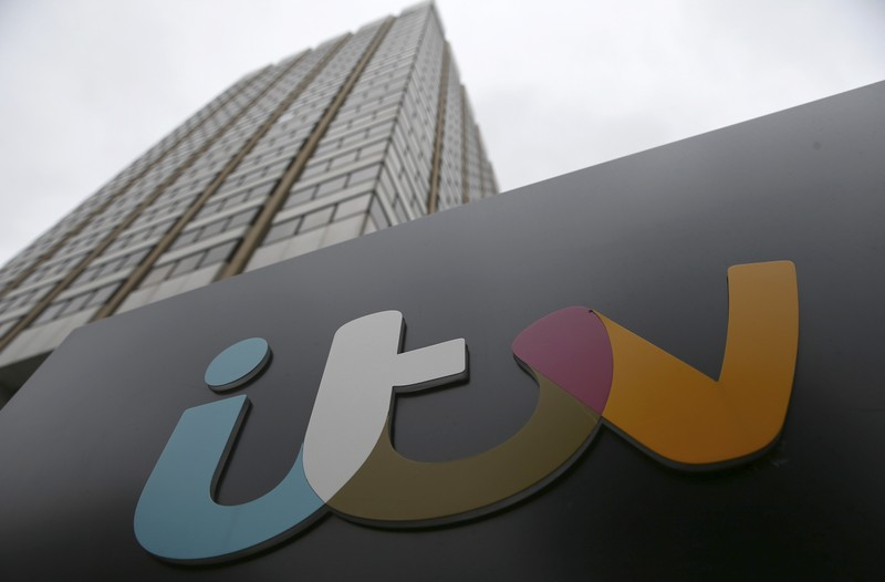 File photo of a company sign displayed outside an ITV studio in London