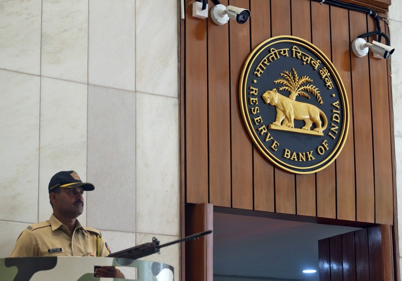 FILE PHOTO: A policeman stands guard at the entrance of the Reserve Bank of India headquarters in Mumbai
