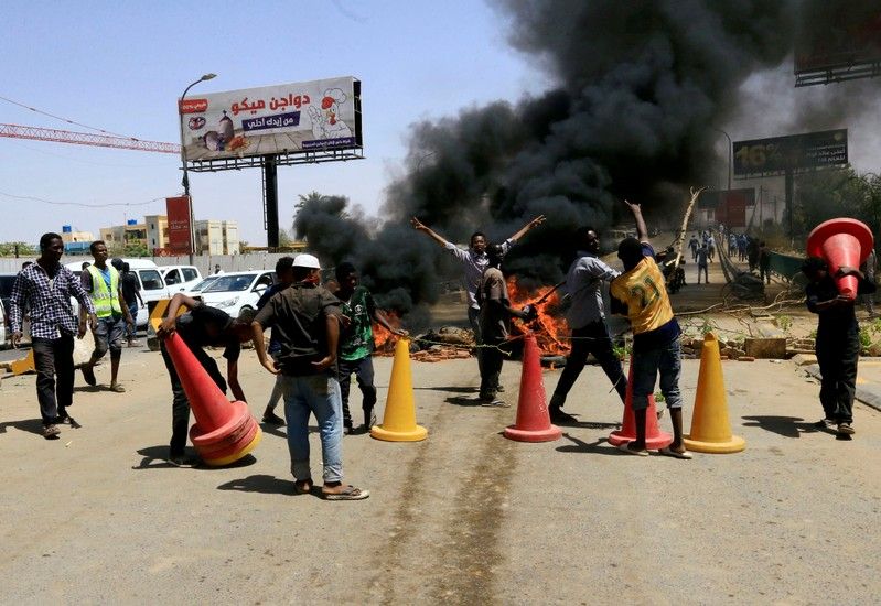 FILE PHOTO: Sudanese protesters burn tyres and barricade the road leading to al-Mek Nimir Bridge crossing over Blue Nile; that links Khartoum North and Khartoum