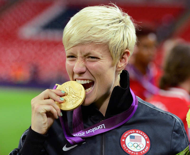 FILE PHOTO: Rapinoe of the U.S. celebrates after defeating Japan in the women's final soccer match at the London 2012 Olympic Games in London at Wembley Stadium