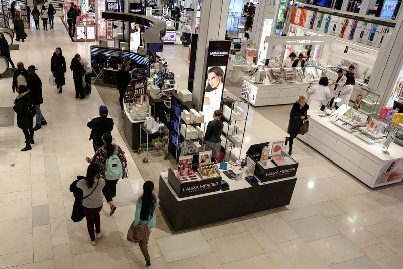 FILE PHOTO: People shop at Macy's Department store in New York