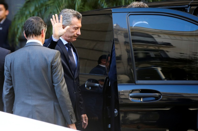 FILE PHOTO: Argentina's President, Mauricio Macri, waves to the press after attending the wake of lawmaker Hector Olivares, inside the National Congress in Buenos Aires