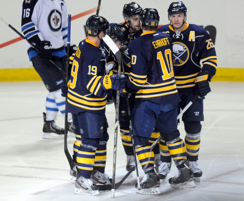 Buffalo Sabres Hodgson, Ehrhoff and Vanek celebrate Vanek's goal with teammates, against the Winnipeg Jets during the second period of their NHL hockey game in Buffalo