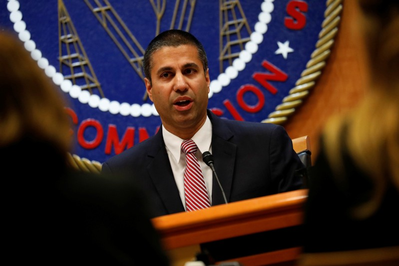FILE PHOTO: Chairman Ajit Pai speaks ahead of the vote on the repeal of so called net neutrality rules at the Federal Communications Commission in Washington