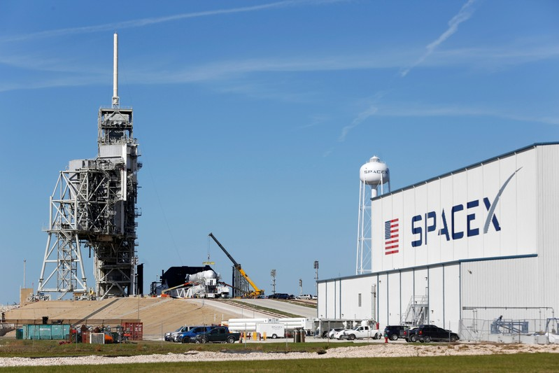 Musk gets head start on Bezos launching SpaceX's own satellites