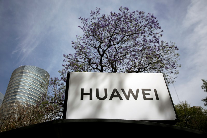 FILE PHOTO: The Huawei logo is seen at a bus stop in Mexico City