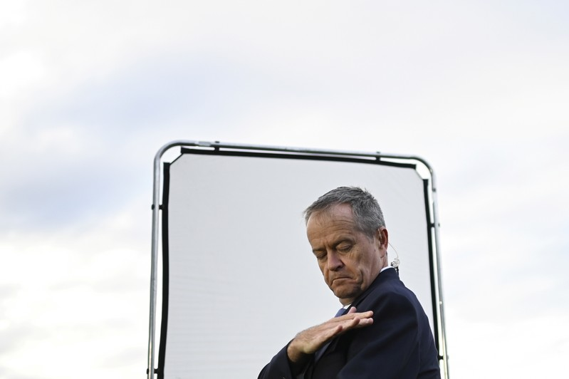Australian Opposition Leader Bill Shorten is seen waiting for the start of a morning TV show interview after a visit to the Sydney Markets in Sydney