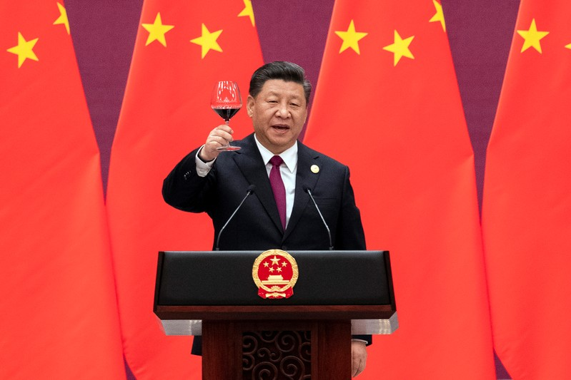 Chinese President Xi Jinping raises his glass and proposes a toast at the end of his speech during the welcome banquet, after the welcome ceremony of leaders attending the Belt and Road Forum at the Great Hall of the People in Beijing