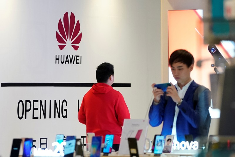 Huawei smartphones are seen displayed inside a shopping mall in Shanghai