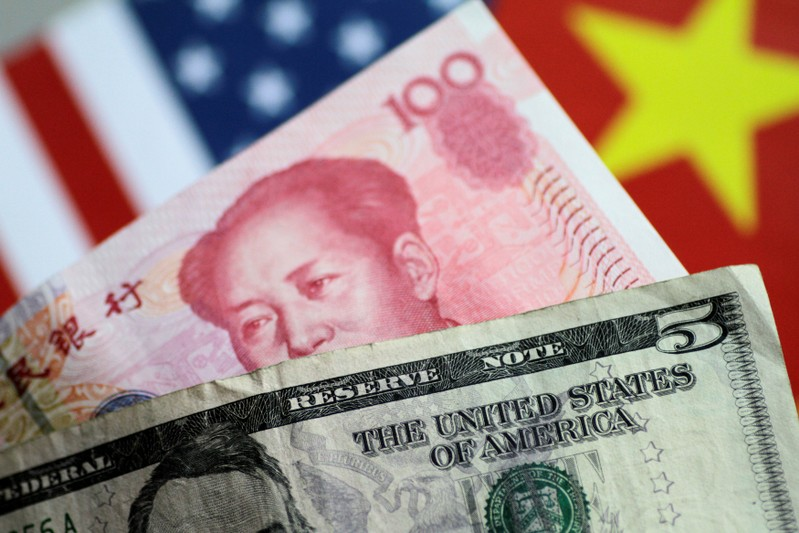 FILE PHOTO: Illustration photo of U.S. Dollar and China Yuan notes